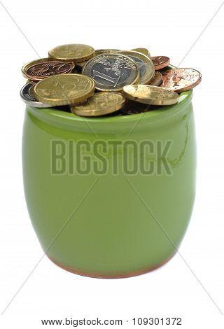 Ceramic green pot full of euro coins