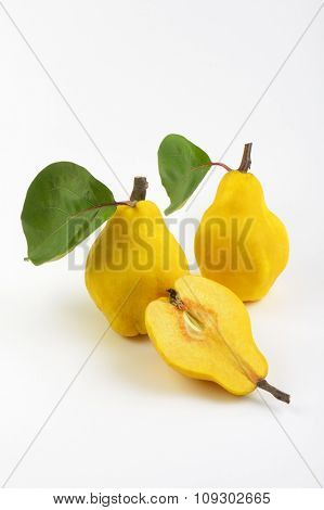 two and half yellow pears on white background