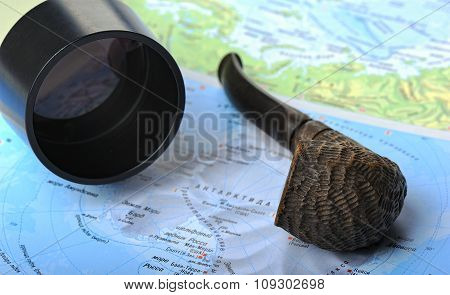 Marine still life with geographical maps a telescope and smoking pipe