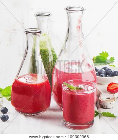 Healthy Fresh Smoothies On  White Wooden Table.