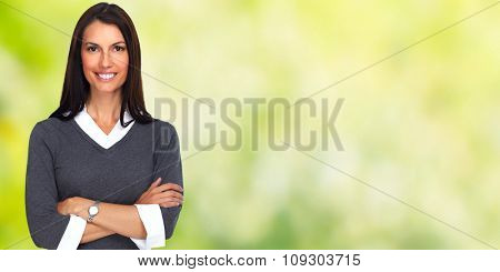 Young smiling business woman over green banner background.