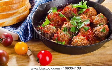 Homemade Meatballs With  Sauce And Herbs.