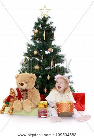 little girl at the Christmas tree