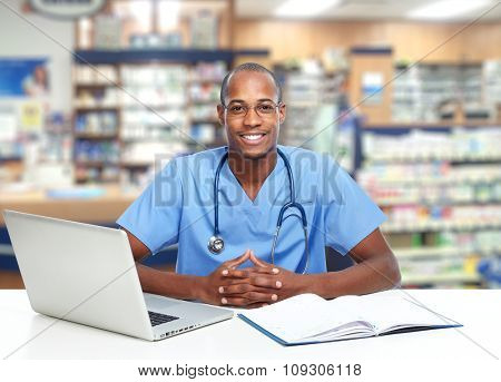 African-American doctor man over hospital background.