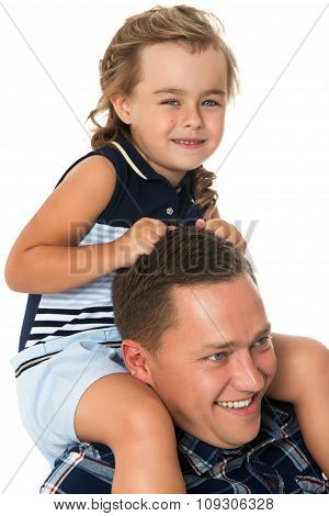 Girl sitting on dad's neck