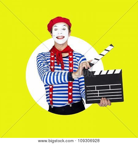 Emotional funny mime actor wearing sailor suit, red beret posing on color white green background.