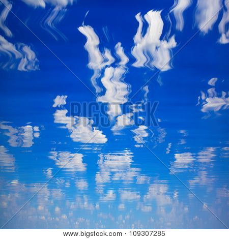 natural landscape with sky with clouds reflected in water