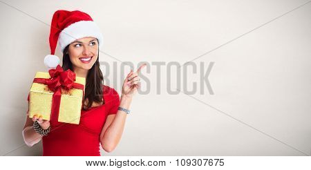 Happy Santa woman with Christmas gift over abstract background.