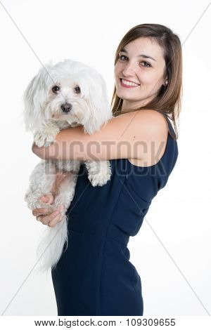 A Studio Image Of A Young Woman,  With Her White Dog, Huging It, Both Posing.