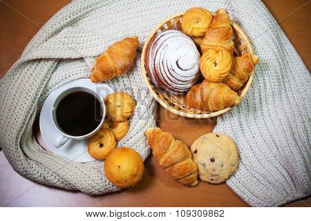 Cookies, Pastries,  Coffee Cup And Gray Scarf On Wooden Background