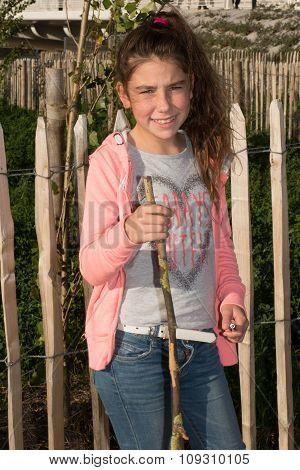 Happy And Pretty Little Girl Having Fun Outside