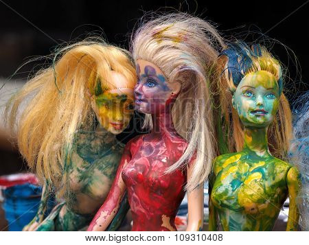 Portrait of dolls, painted in all the colors of the rainbow