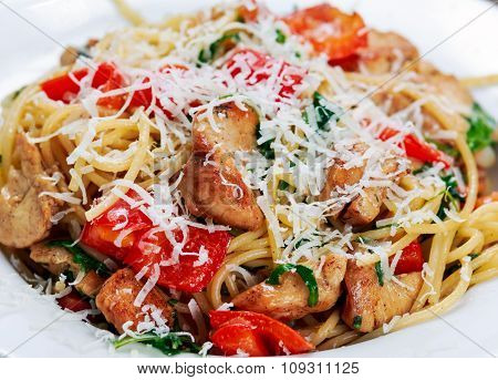 Close Up Italian Chicken Breast Pasta Spaghetti With Red Pepper, Parmesan Cheese And Wild Rocket  Li