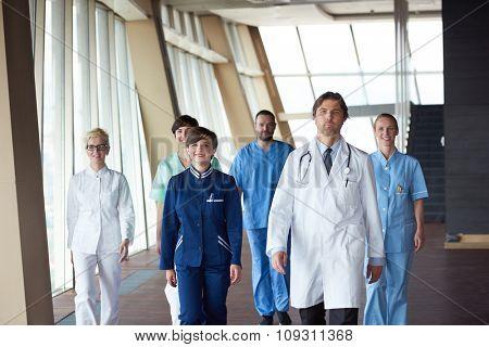 doctors team walking in modern hospital corridor indoors, poeople group