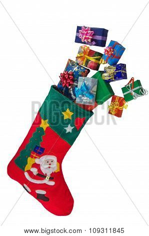 Christmas Stocking And Gifts Isolated Over White.