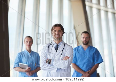 group of medical staff at hospital, handsome doctor in front of team, people group  standing together in background