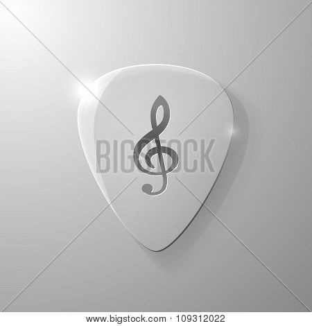 Treble clef silhouette on a glass plectrum
