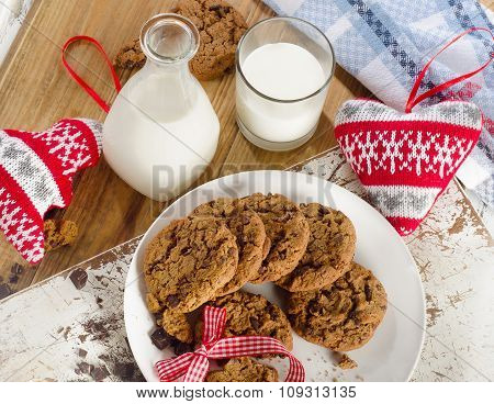 Chocolate Chip Cookies With Bootle Of Milk On Wooden Background.