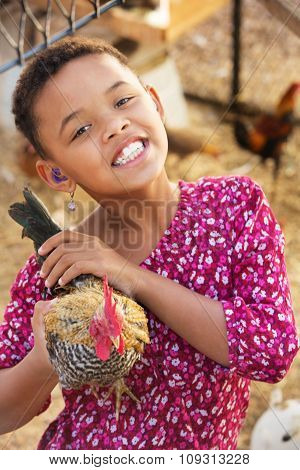Cute Child With Hen