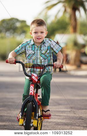 Cute Child On Bike