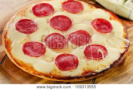 Pizza Pepperoni Served On A Wooden Table.