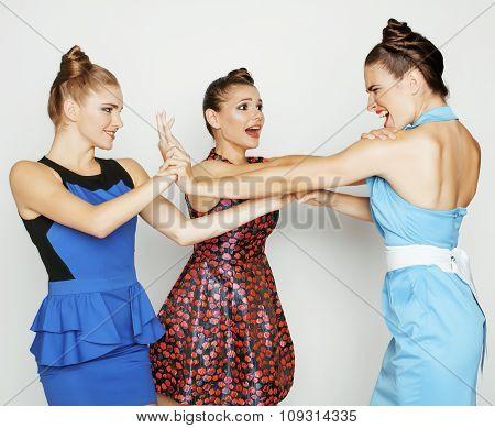 three elegant fashion woman fighting on white background, bright dresses