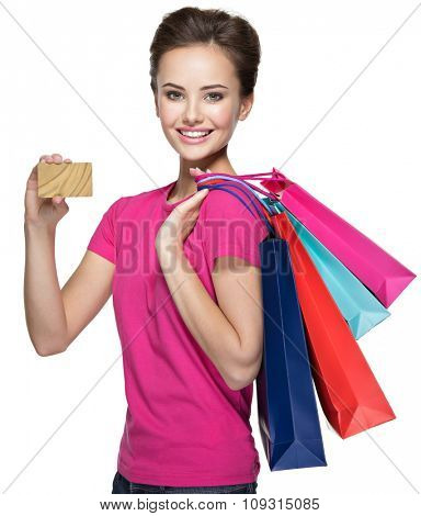 Happy  woman with shopping  bags and credit card over white background