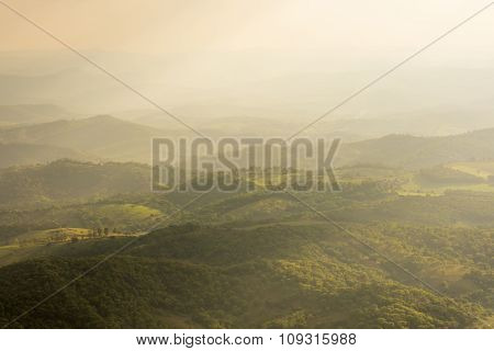 Hilly Valley And Diffused Sunlight