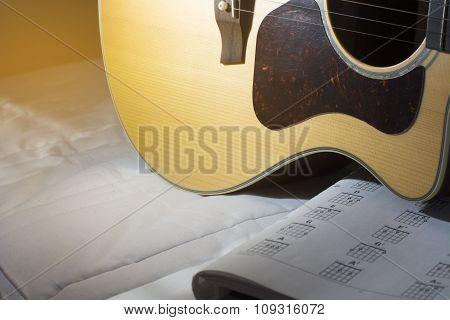 Guitar acoustic ,pickguard and music book.