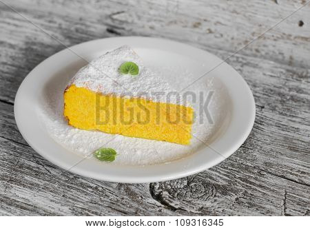 Cottage Cheese Casserole With Pumpkin  On A White Plate On A Light Wooden Board