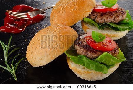 Homemade Burgers On A Dark Background.