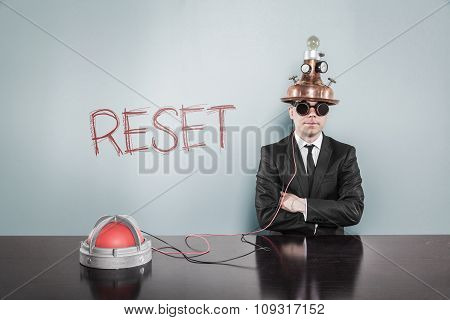 Reset concept with vintage businessman and calculator