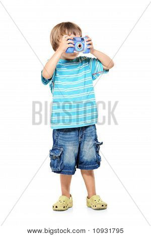 Full Length Portrait Of A Little Boy Taking Pictures With A Camera
