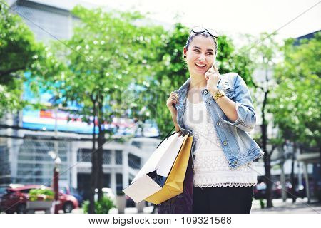Woman Shopping Outdoors Talking Mobile Phone Concept