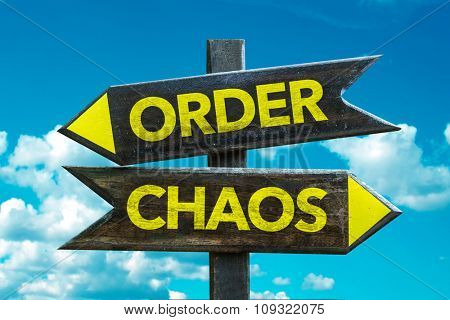Order - Chaos signpost with sky background
