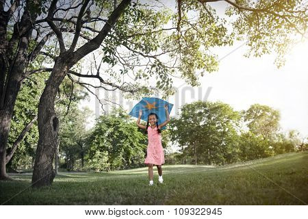 African Girl Playing Kite Activity Concept
