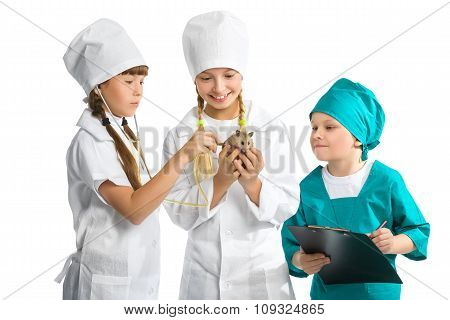 Cute little children dressed like doctor treated hamster isolated on white background. Veterinary co