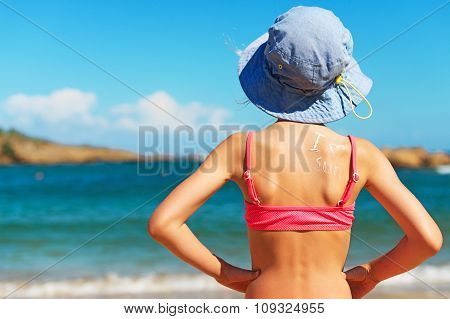 Little Girl In Panama Hat Against Sea Background. Space For Text.