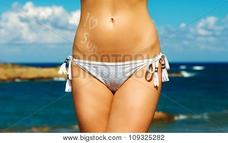 Sexy Female Body On Sea Background. Space For Your Text.