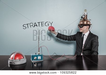 Strategy concept with businessman holding brain