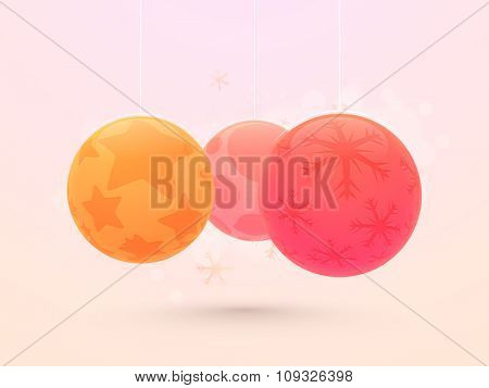 Creative colorful hanging Xmas Balls on pink background for Merry Christmas celebration.