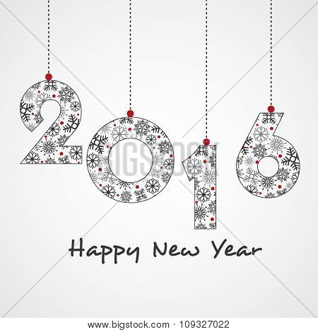 Snowflakes decorated hanging text 2016 on glossy grey background for Happy New Year celebration.