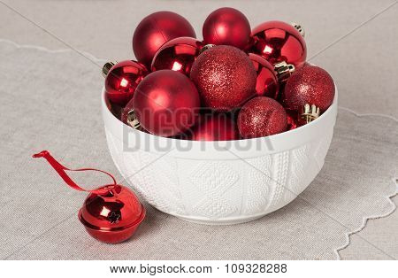 Christmas Decoration. Red Balls And Bells. Natural Linen Backgro
