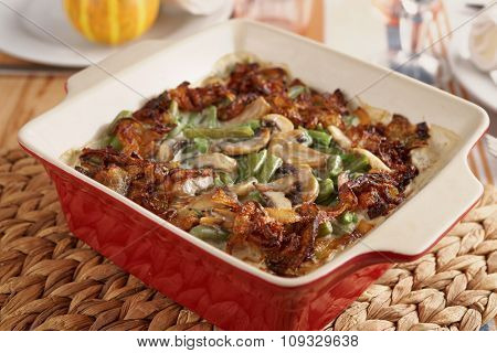 Baked green beans with caramelized onions and mushrooms on a Thanksgiving table