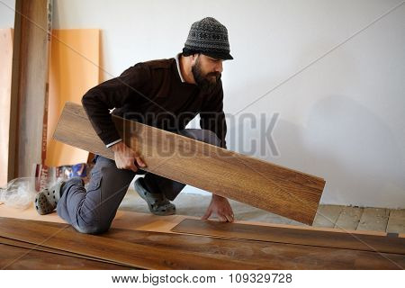 Worker Laying Parquet In A Room