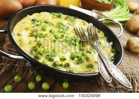 Omelette With Green Peas, Potatoes And Cheese