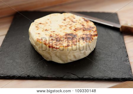 Grilled cheese on a slate cutting board