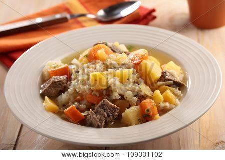 Irish coddle in a rustic bowl closeup
