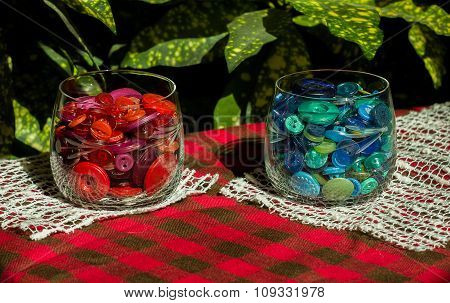 Red And Blue Buttons In Two Cups