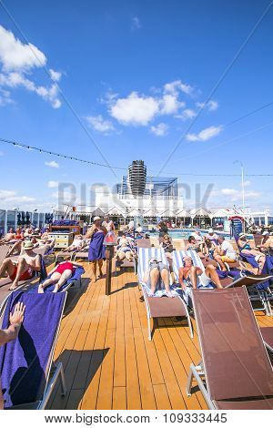Caribbean Sea, Bahamas - February 13, 2015: Tourists Relax And Take A Sun Bath On The Upper Deck Of